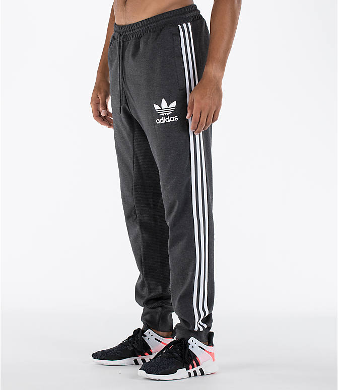Front Three Quarter view of Men's adidas Curated Cuffed Jogger Pants in Heather Grey/White