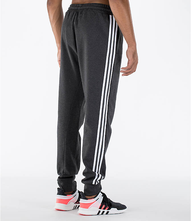 Back Right view of Men's adidas Curated Cuffed Jogger Pants in Heather Grey/White