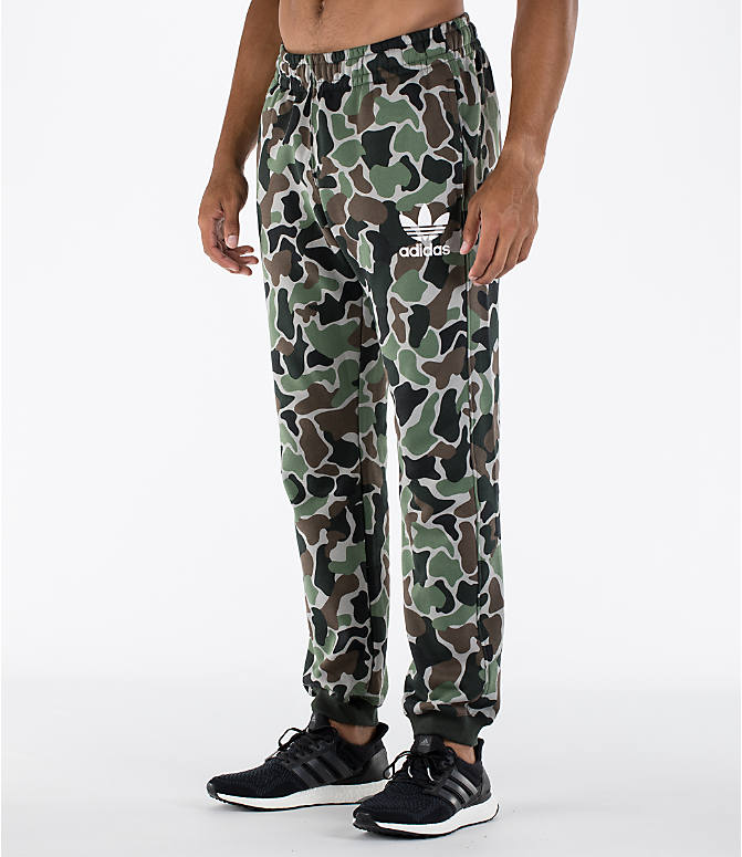 Front Three Quarter view of Men's adidas Camo Cuffed Jogger Pants in Camo/White