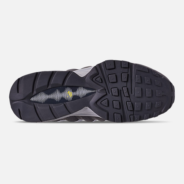 Bottom view of Boys' Big Kids' Nike Air Max 95 Mekbuda Casual Shoes in Off Noir/Dynamic Yellow/Atmosphere Grey