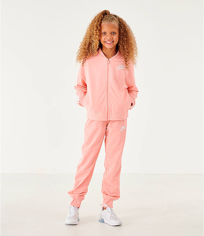 Front Three Quarter view of Girls' Nike Sportswear Track Suit in Bleached Coral