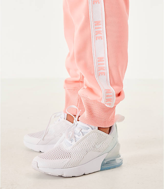 On Model 6 view of Girls' Nike Sportswear Track Suit in Bleached Coral