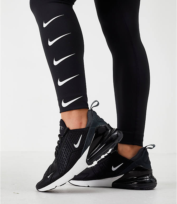 On Model 5 view of Women's Nike Swoosh Running Tights in Black/White