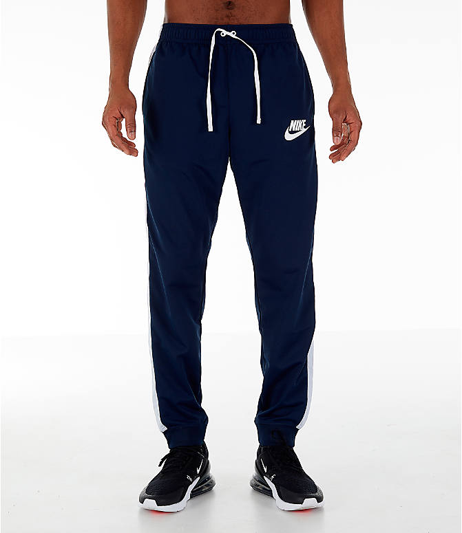 Front Three Quarter view of Men's Nike Sportswear Hybrid Jogger Track Pants in Obsidian