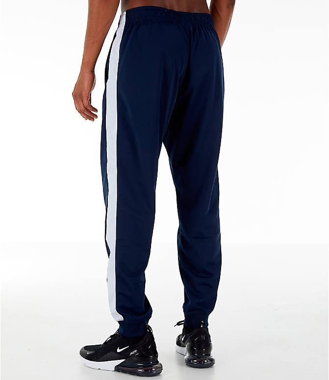 Back Left view of Men's Nike Sportswear Hybrid Jogger Track Pants in Obsidian