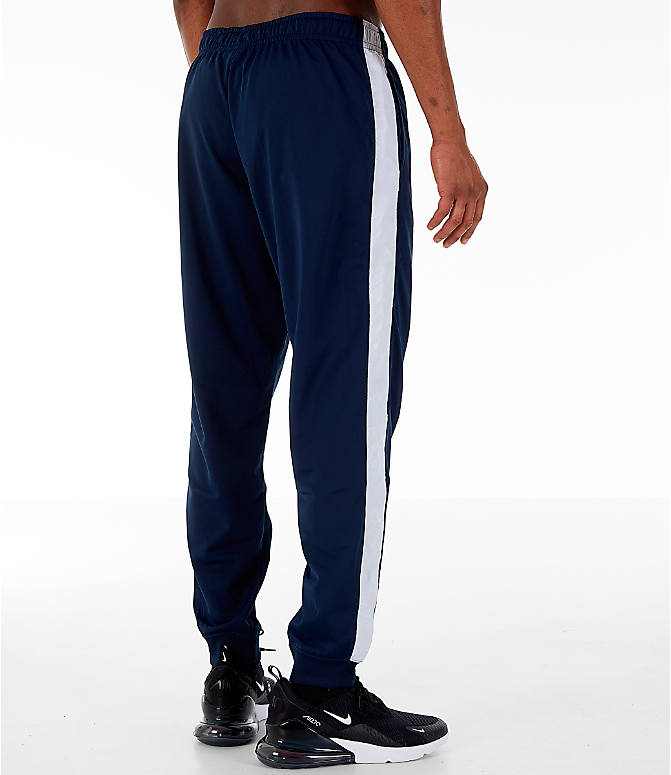 Back Right view of Men's Nike Sportswear Hybrid Jogger Track Pants in Obsidian