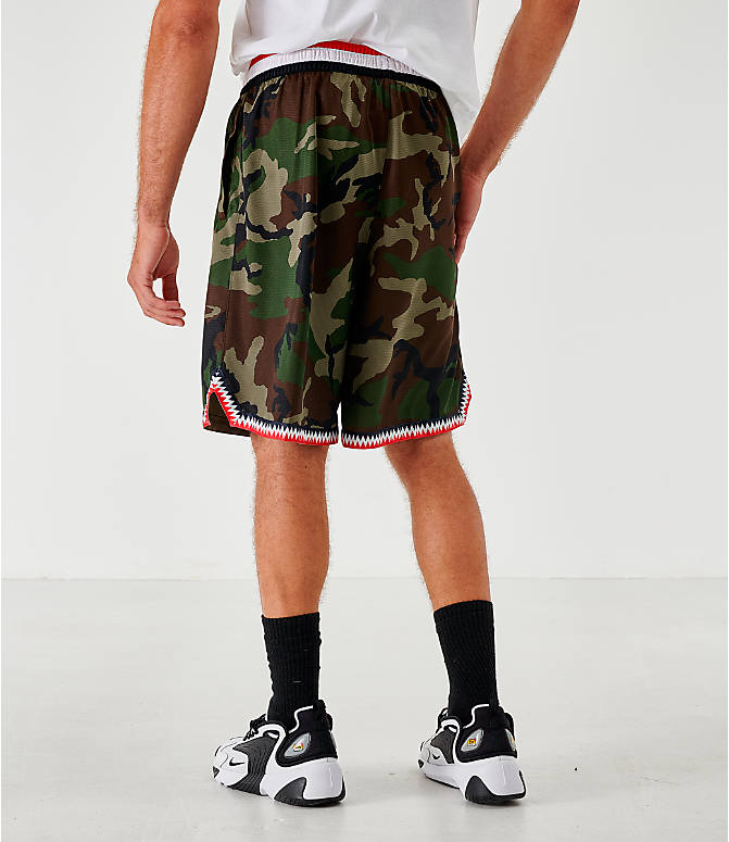 Back Left view of Men's Nike Dri-FIT DNA Camo Basketball Shorts in Medium Olive