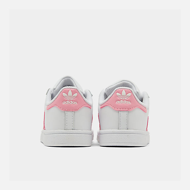 Left view of Girls' Toddler adidas Superstar Casual Shoes in White/Pink