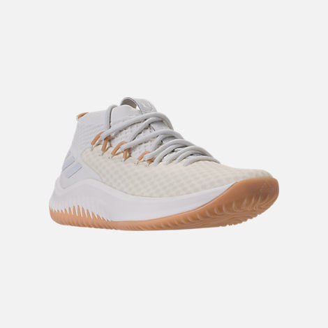 Three Quarter view of Men's adidas Dame 4 Basketball Shoes in White/Gum