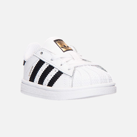 Three Quarter view of Kids' Toddler adidas Superstar Casual Shoes in White/Black