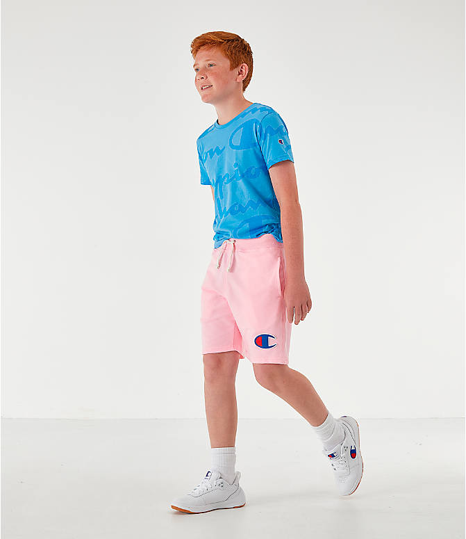 Front Three Quarter view of Kids' Champion Terry Fleece Shorts in Pink Candy