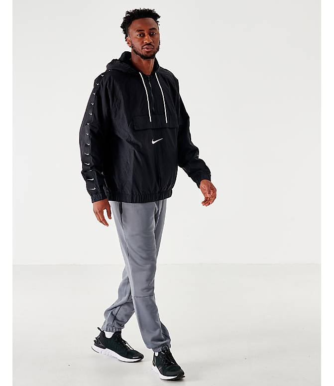 Front Three Quarter view of Men's Nike Sportswear Swoosh Woven Jacket in Black