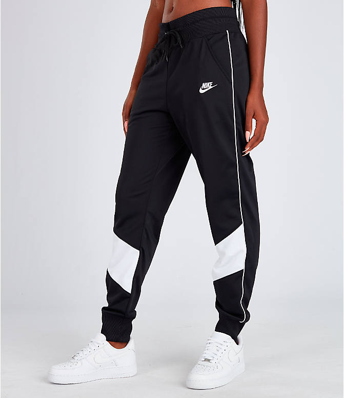 Front Three Quarter view of Women's Nike Sportswear Heritage Track Pants in Black/White