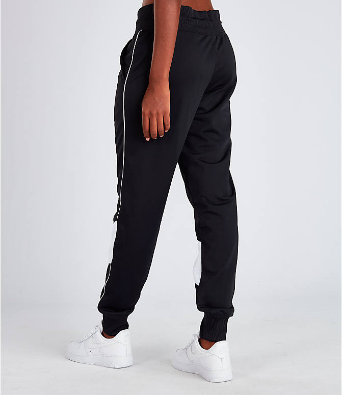 Back Left view of Women's Nike Sportswear Heritage Track Pants in Black/White
