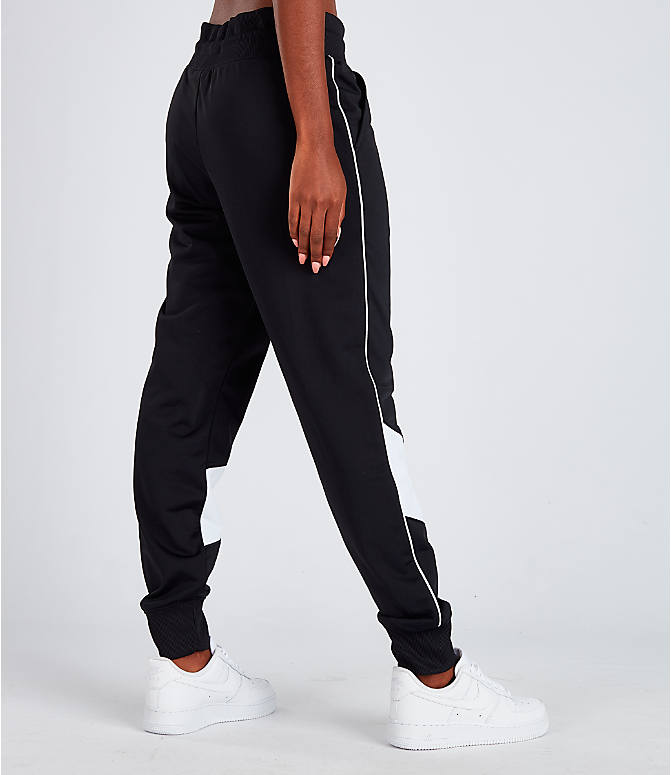 Back Right view of Women's Nike Sportswear Heritage Track Pants in Black/White