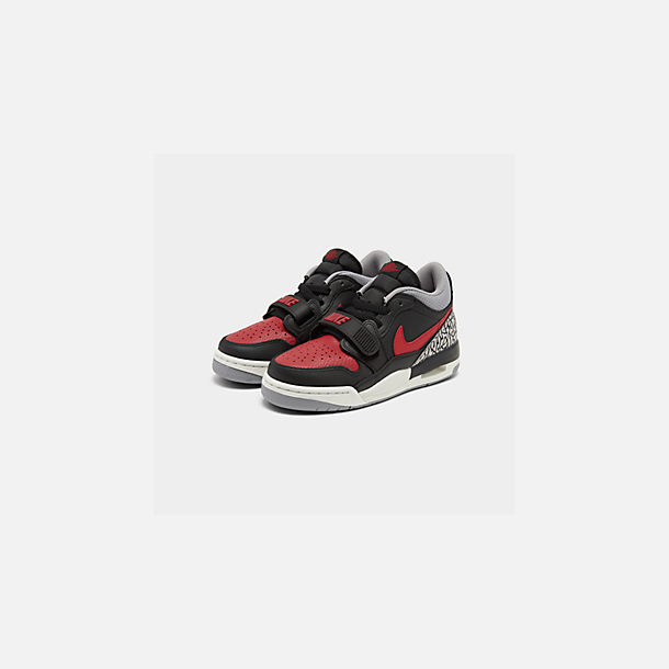 Three Quarter view of Boys' Big Kids' Jordan Legacy 312 Low Off-Court Shoes in Black/Varsity Red/Black/Cement Grey
