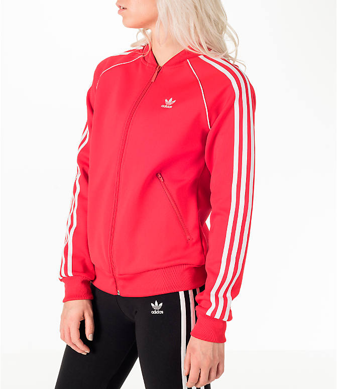 Front Three Quarter view of Women's adidas Originals Superstar Track Jacket in Red/White