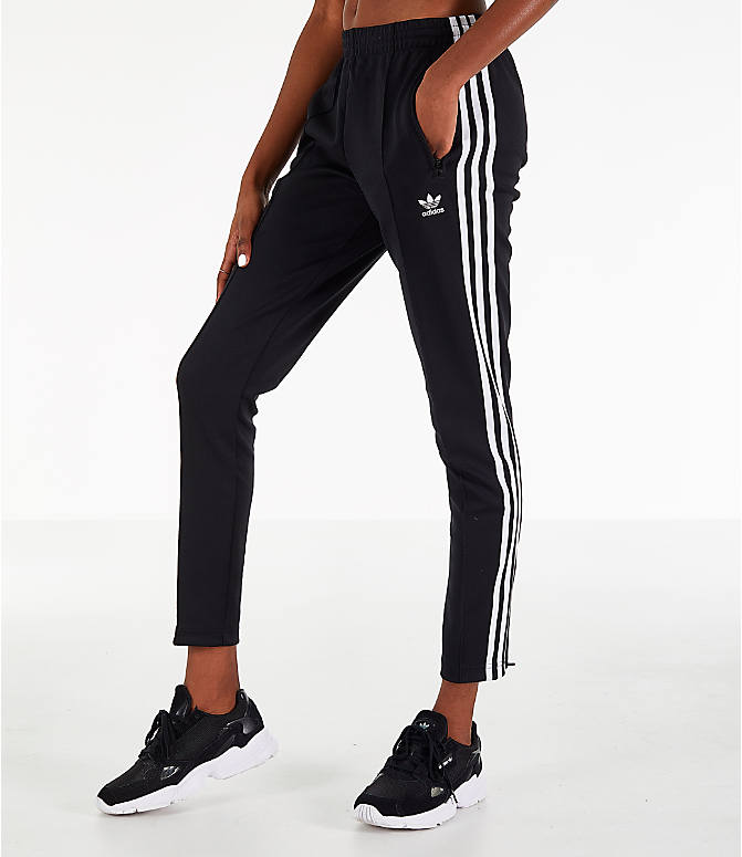 Front view of Women's adidas Originals Superstar Track Pants in Black