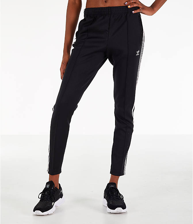 Front Three Quarter view of Women's adidas Originals Superstar Track Pants in Black