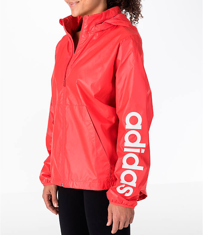 Front Three Quarter view of Women's adidas Linear Training Windbreaker Jacket in Coral/White