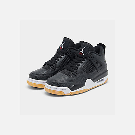 Three Quarter view of Big Kids' Air Jordan Retro 4 SE Basketball Shoes in Black/White/Gum/Nubuck