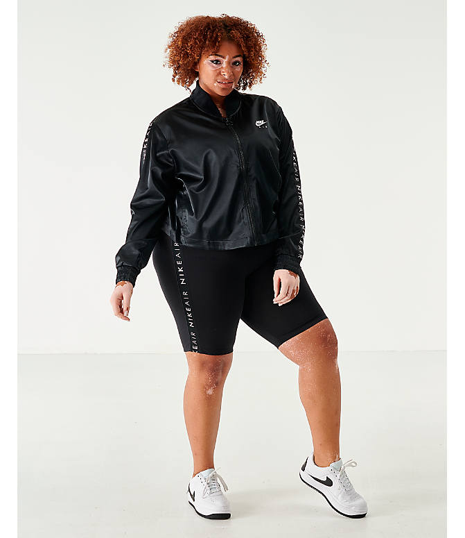 Front Three Quarter view of Women's Nike Air Satin Track Jacket - Plus Size in Black