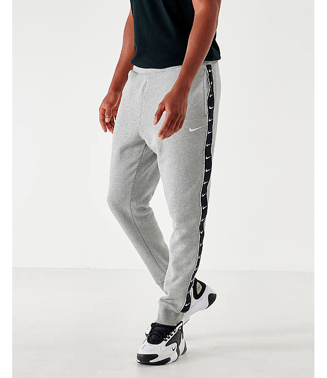 Front view of Men's Nike Sportswear Swoosh Fleece Jogger Pants in Dark Grey Heather