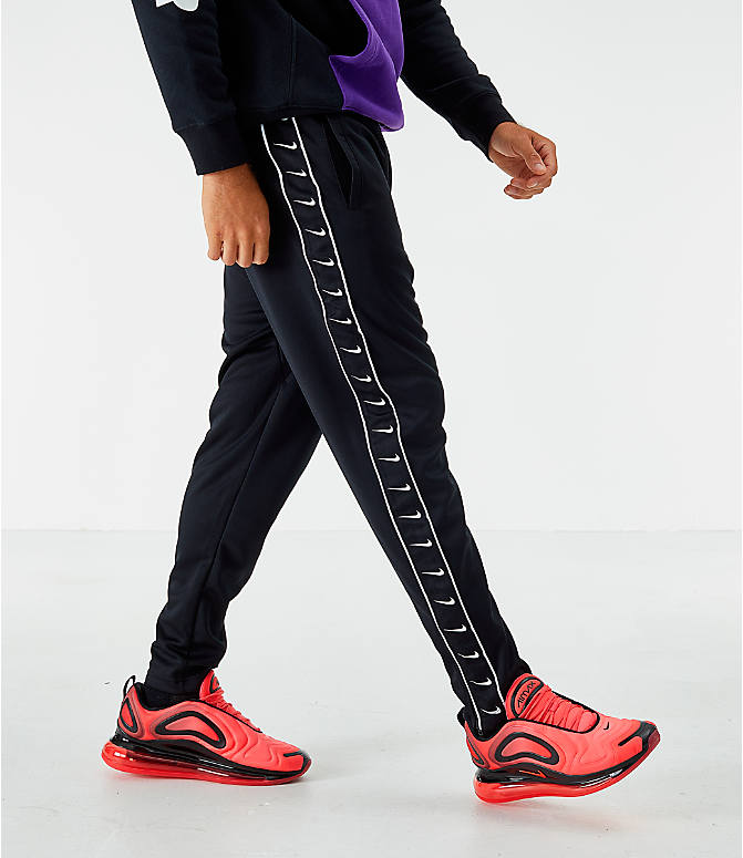 Front view of Men's Nike Sportswear Swoosh Training Pants in Black