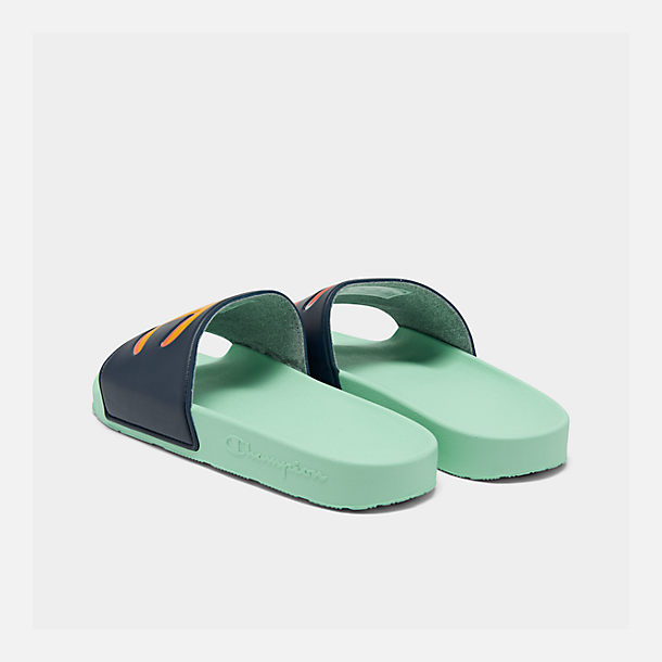 Left view of Men's Champion IPO Color Block Slide Sandals in Navy Multi/Waterfall Green