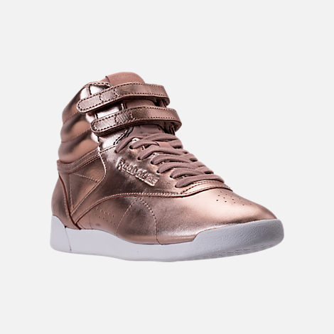 Three Quarter view of Women's Reebok Freestyle Hi Metallic Casual Shoes in Rose Gold/White/Silver Peony