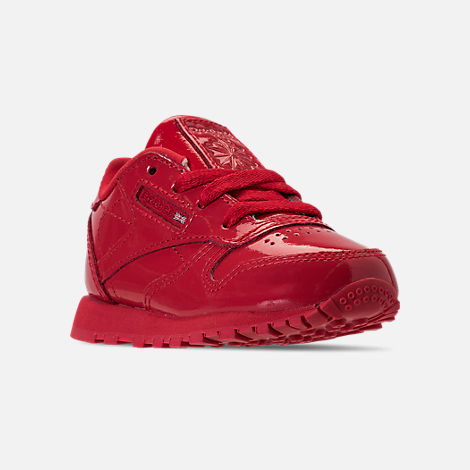 Three Quarter view of Girls' Toddler Reebok Classic Leather Casual Shoes in Red
