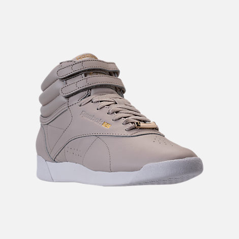 Three Quarter view of Women's Reebok Freestyle Hi Muted Casual Shoes in Sandstone/White