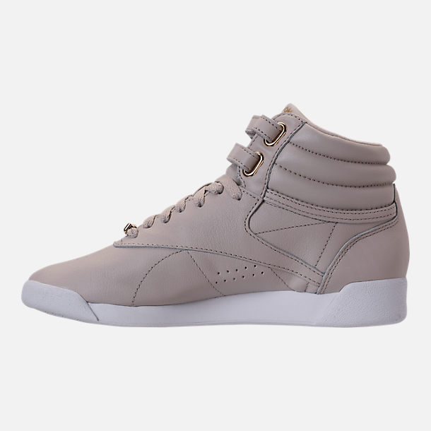 Left view of Women's Reebok Freestyle Hi Muted Casual Shoes in Sandstone/White