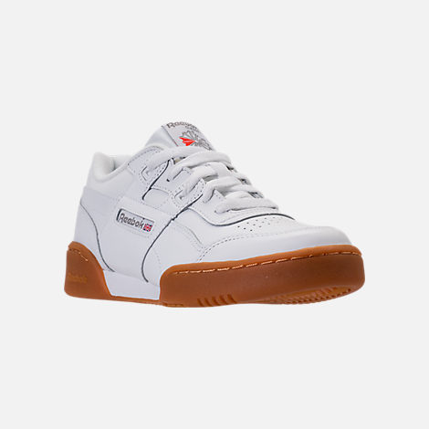 Three Quarter view of Boys' Grade School Reebok Classics Workout Plus Casual Shoes in White/Gum