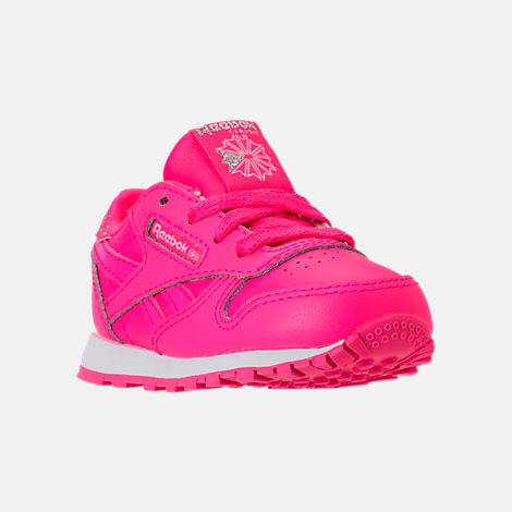 Three Quarter view of Girls' Toddler Reebok Classic Leather Girl Squad Casual Shoes in Acid Pink/White