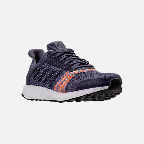 Three Quarter view of Women's adidas UltraBOOST ST Running Shoes in Raw Indigo/Noble Ink/Hi-Res Orange