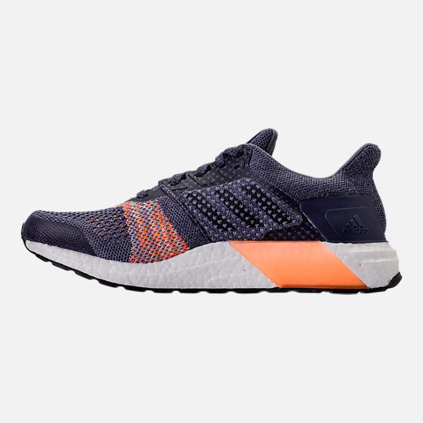 Left view of Women's adidas UltraBOOST ST Running Shoes in Raw Indigo/Noble Ink/Hi-Res Orange