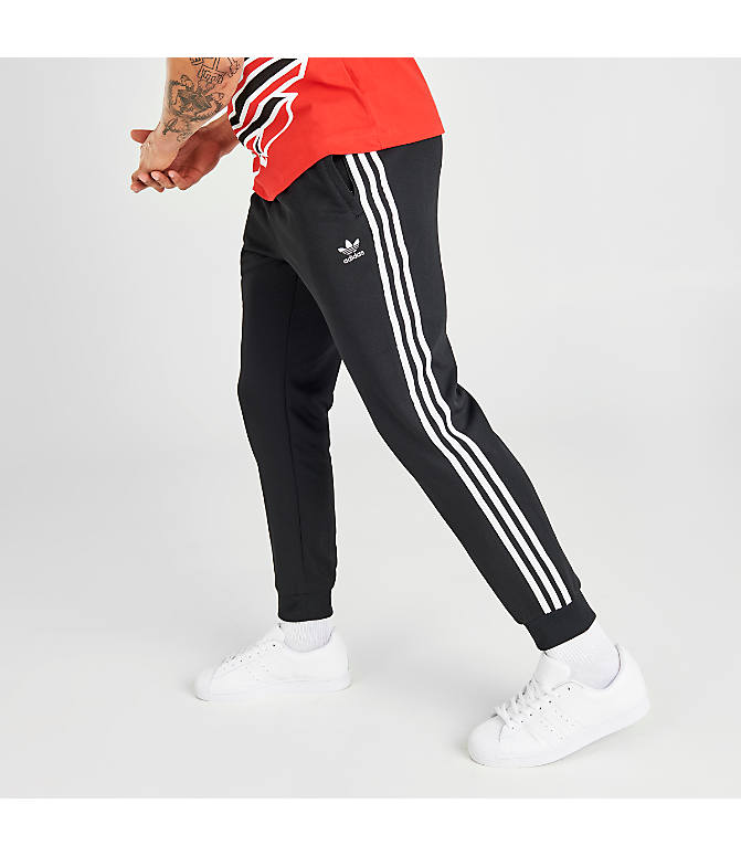 Front Three Quarter view of Men's adidas Originals adicolor Superstar Track Pants in Black