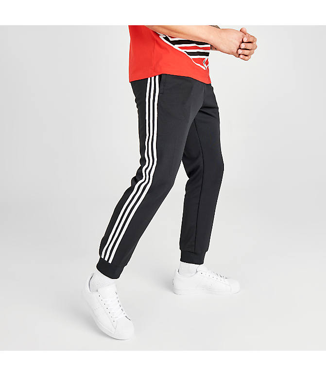 Back Left view of Men's adidas Originals adicolor Superstar Track Pants in Black