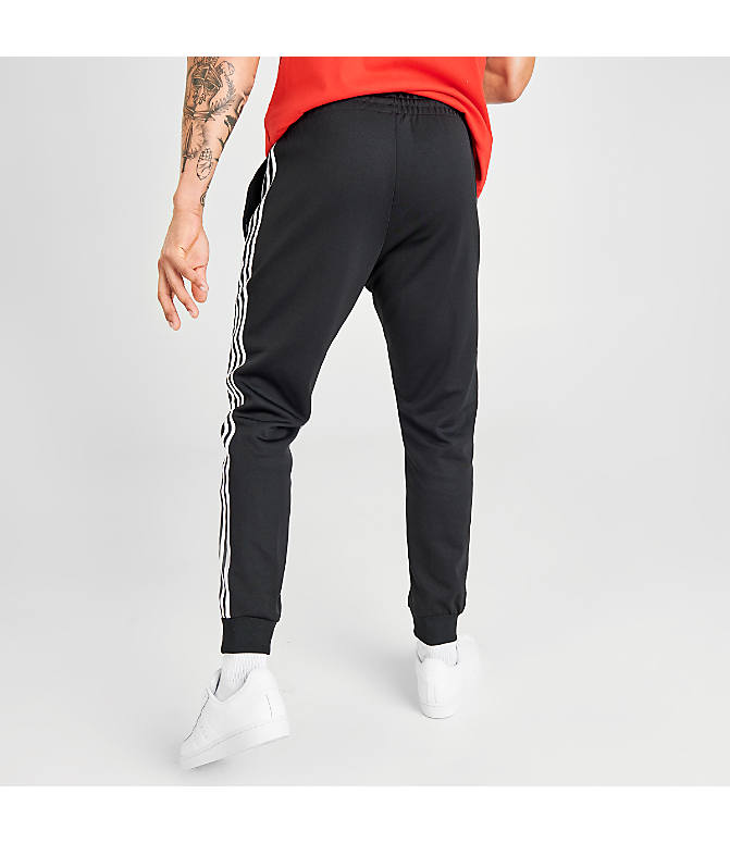 Back Right view of Men's adidas Originals adicolor Superstar Track Pants in Black