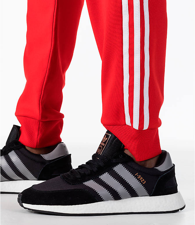 Detail 2 view of Men's adidas Originals adicolor Superstar Track Pants in Red