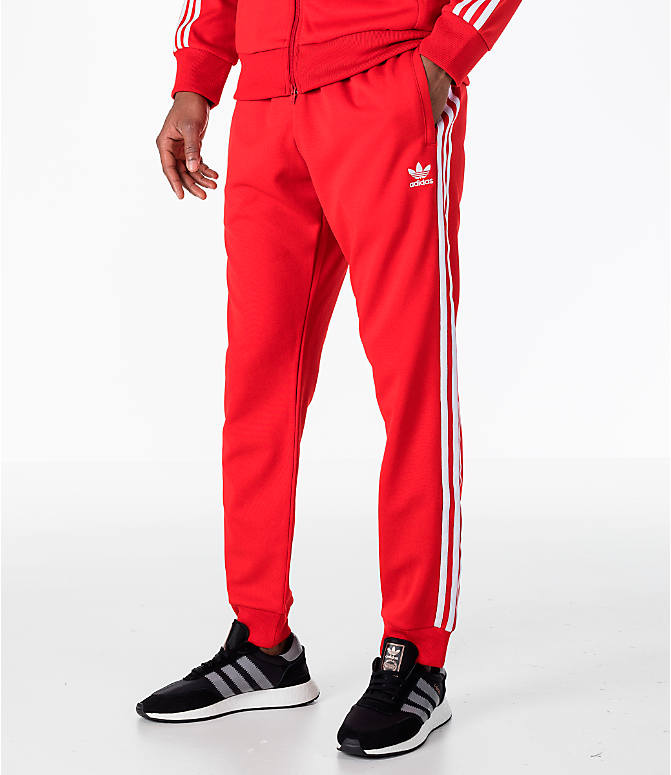 Front view of Men's adidas Originals adicolor Superstar Track Pants in Red