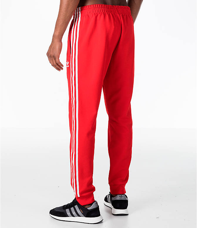 Back Left view of Men's adidas Originals adicolor Superstar Track Pants in Red