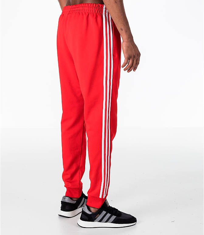 Back Right view of Men's adidas Originals adicolor Superstar Track Pants in Red
