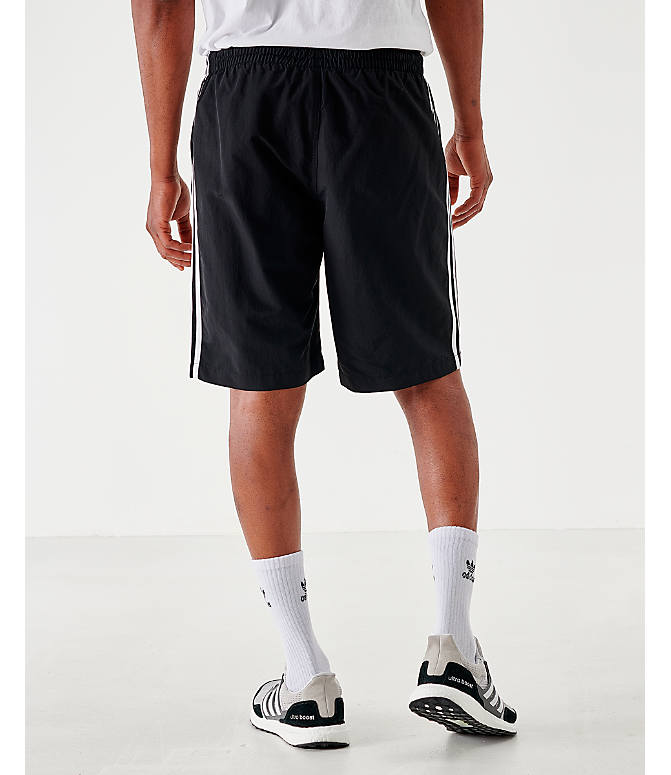 Back Left view of Men's adidas Originals 3-Stripes Swim Shorts in Black