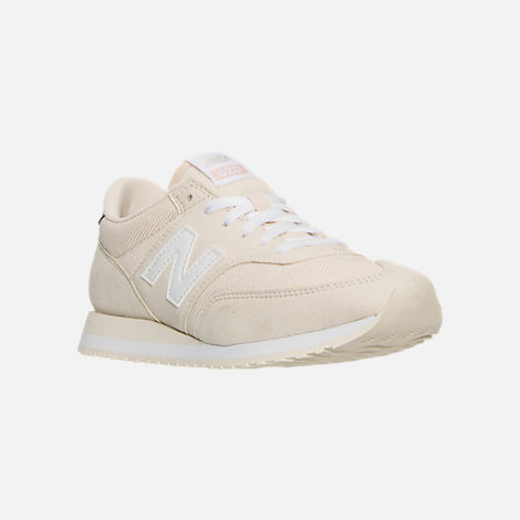 Three Quarter view of Women's New Balance 620 Casual Shoes in White/Pink