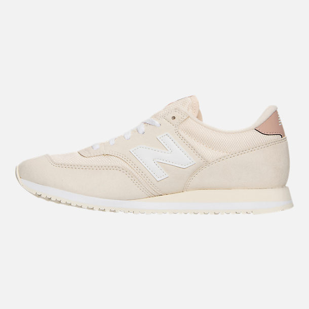 Left view of Women's New Balance 620 Casual Shoes in White/Pink