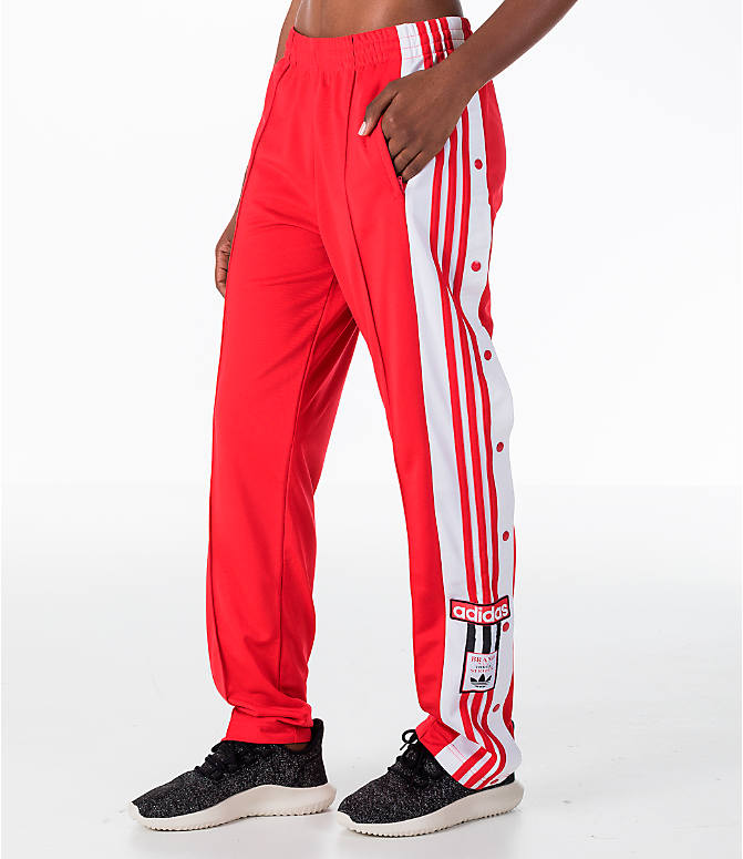 Front view of Women's adidas Originals Breakaway Pants in Red/White