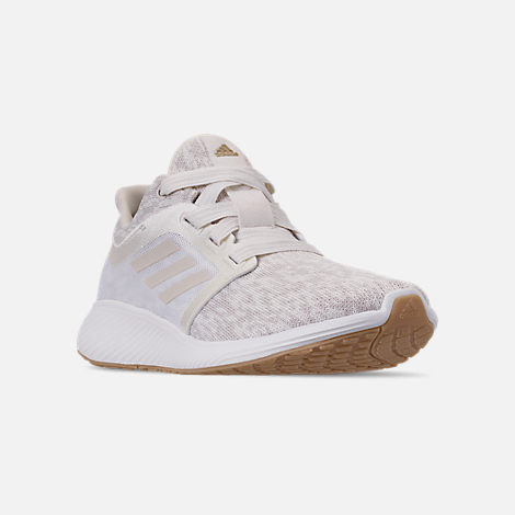 Three Quarter view of Women's adidas Edge Lux Running Shoes in Raw White/Cloud White/Gold Metallic
