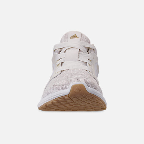 Front view of Women's adidas Edge Lux Running Shoes in Raw White/Cloud White/Gold Metallic